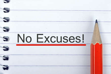 excuse: No Excuses text on notepad and red pencil