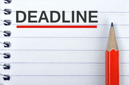 Deadline text on notepad and red pencil