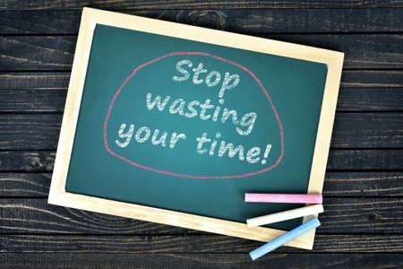 reconsider: Stop wasting your time text on school board and chalk