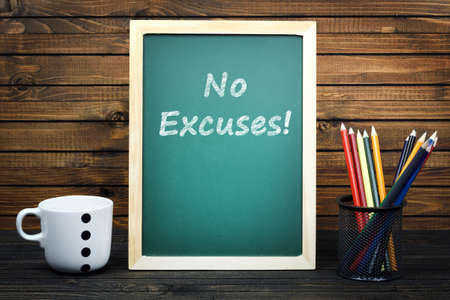 justify: No Excuses text on school board and group of pencils