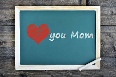 nostalgy: Love mom text on school board and chalk on wooden table