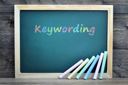 metadata: Keywording text on school board and chalk on wooden table