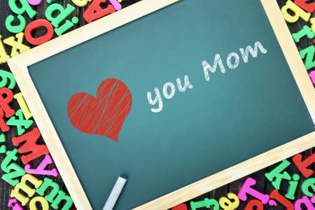 nostalgy: Love mom text on school board and magnetic letters Stock Photo