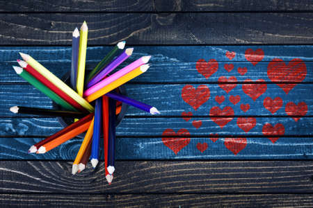 love declaration: Love concept with many heart shape painted and group of pencils on wooden table
