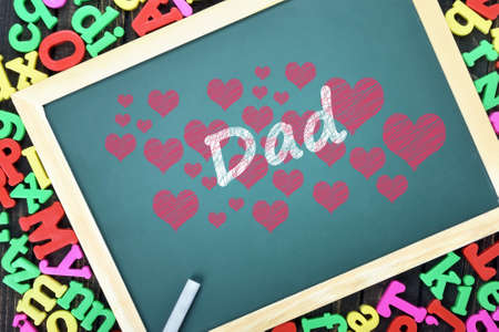 nostalgy: Love Dad text on school board and magnetic letters Stock Photo