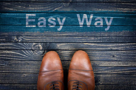 easy way: Easy way message and business shoes on wooden floor Stock Photo