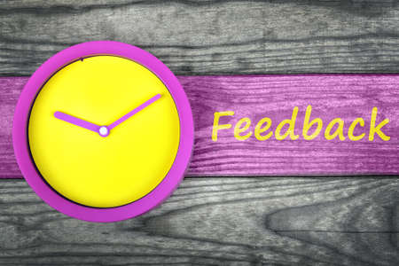 commenting: Feedback message and clock on wooden table