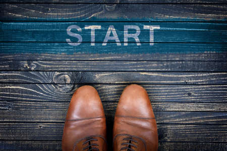 career development: Start message and business shoes on wooden floor Stock Photo