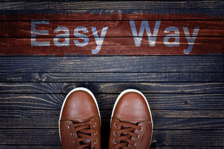 easy way: Easy Way message and sport shoes on wooden floor