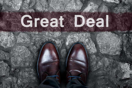 great deal: Great Deal message on asphalt and business shoes Stock Photo