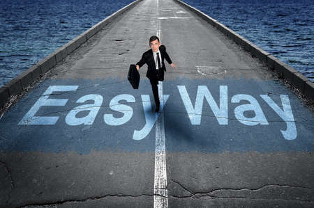 easy way: Easy way message on road and business man
