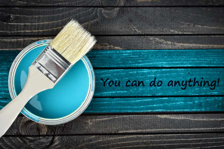 anything: You can do anything message and paintbrush on wooden table