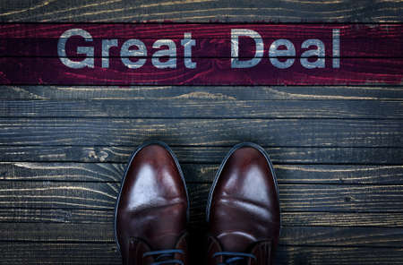 great deal: Great Deal message and business shoes on wooden floor