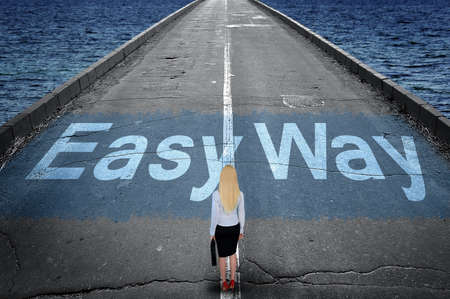 easy way: Easy way message on road and business woman Stock Photo