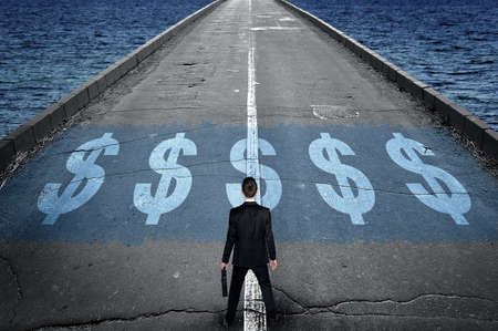 business sign: Dollar sign on road and business man Stock Photo