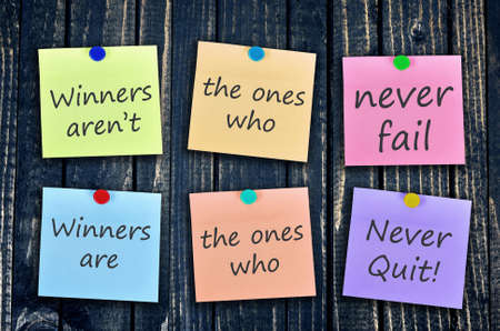 Never Quit message on stickers post on wooden wall