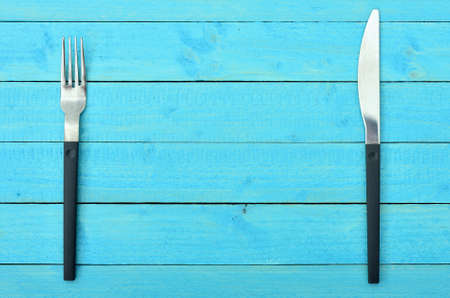Fork and knife on wooden table