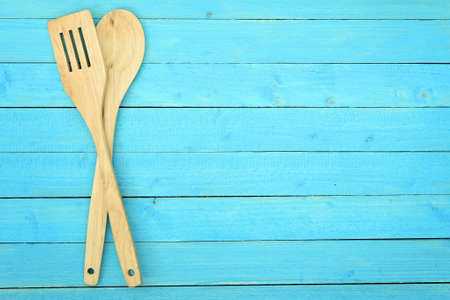 Fork and spoon on wooden table