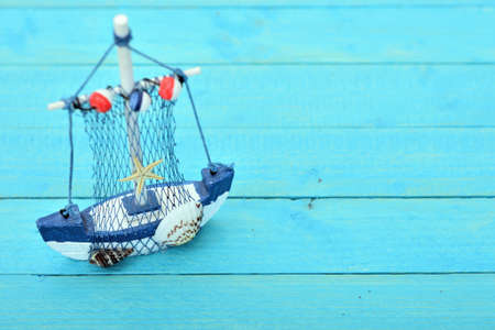 Toy ship on blue wooden table