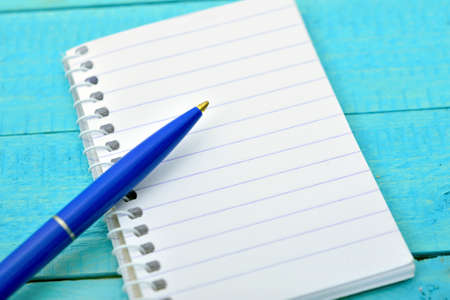 Empty notepad on wooden table Stock Photo