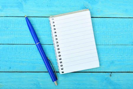 blank note: Empty notepad on wooden table Stock Photo