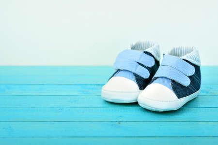 Kid shoes on wooden floor Stock Photo