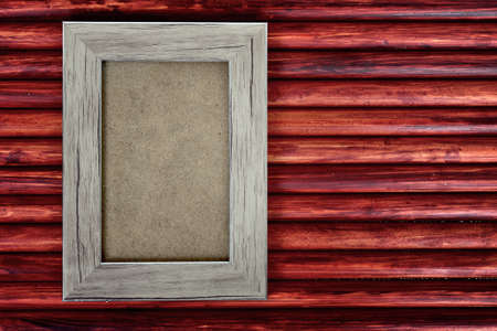 Photo frame on wooden table