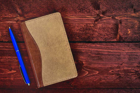 Notepad and pen on wooden table Stock Photo