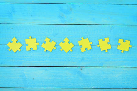 Puzzle pieces on wooden table Stock Photo