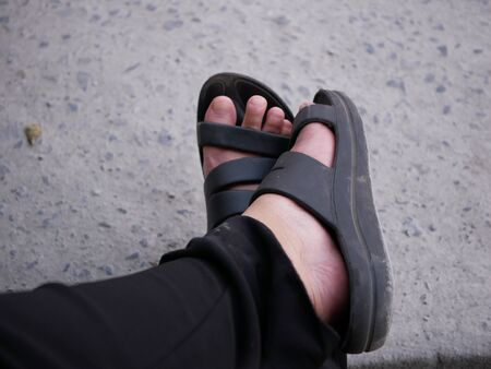 Black footwears in the chill day relax to travel around 版權商用圖片 - 138286827