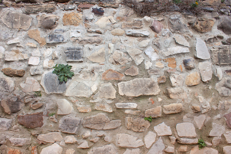 A natural stone wall in Italy. Background and place for inscriptions. Banque d'images