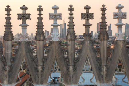 The new skyline seen through the gothic spires of the rooftop of the dome, Milan, Italy Standard-Bild