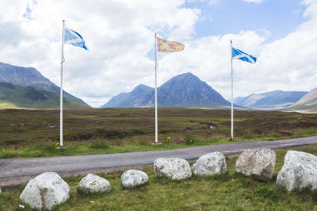 The Saltire or flag of Scotland with Stob Dearg and Buachaille Etive Mor in the background, Rannoch Moor, Glencoe, Scotland Stock Photo
