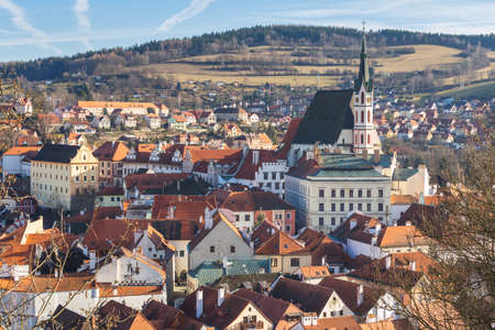 Red tile roofs and towers of the Cesky Crumlov old town, Czech Republic Standard-Bild