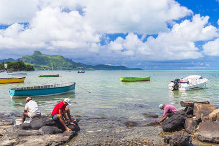 Small boat named pirogue used by fishermen for there living, Mahebourg, Mauritius Stock Photo