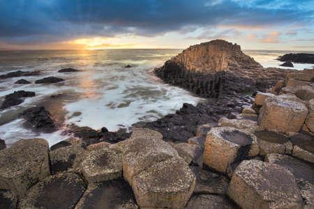 Giant Causeway rocks at sunset in Northern Ireland Reklamní fotografie