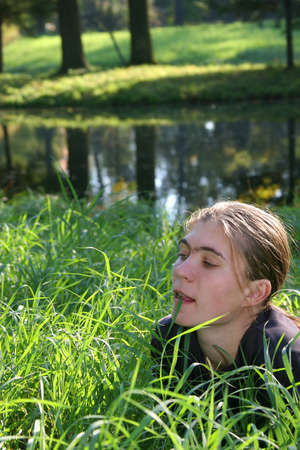 colleen: The girl dreams on coast in a high grass