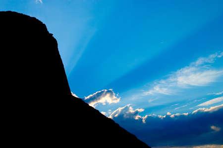 Sun ray in mountains photo