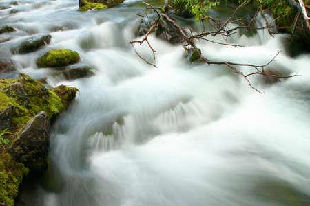 Powerful stream of a stream in mountains Lovozera photo