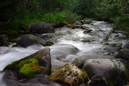 Powerful stream in mountains Stock Photo