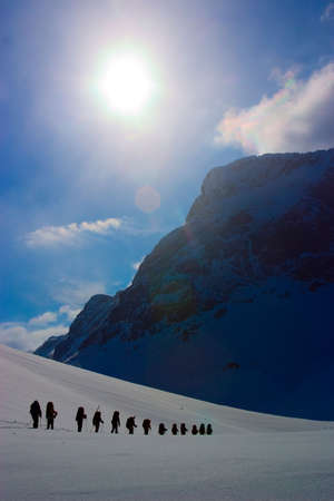 Group of climbers on expedition. Winter Stock Photo