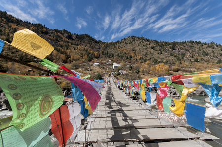 Prayer flags in Tibet on the praying hills under the blue sky