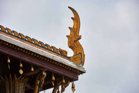 Golden decorations on a temple roof Stock Photo