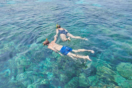 Two people snorkeling in the sea Stock Photo