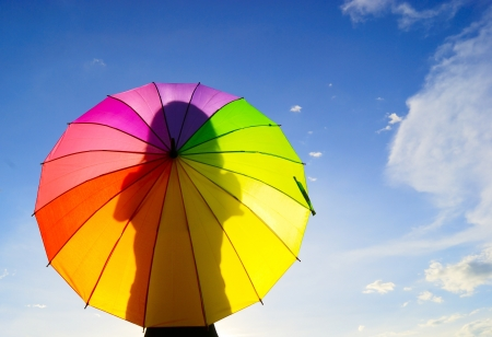 against the sun: Shadow multicolor umbrella woman