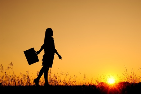 girl in rain: Business woman standing and sunset silhouette