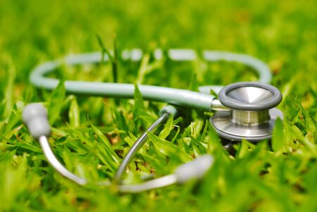 stethoscope on grass photo