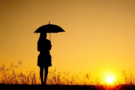 umbrella rain: Umbrella woman and sunset silhouette in Lake