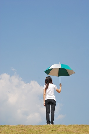 Umbrella woman and blue sky  photo