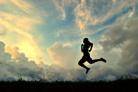 silhouetted: woman running jump at sunset silhouetted
